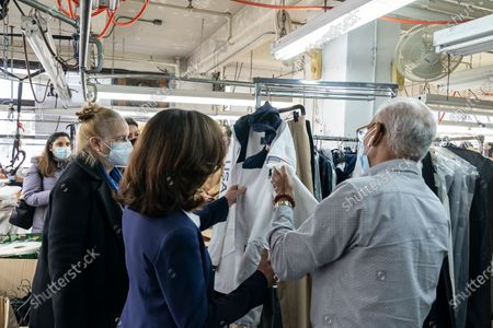 LG Kathy Hochul visits Four Seasons Fashion as part of women-owned nonprofit Garment District for Gowns on 39th street of Manhattan. LG was touring Four Season Fashion company owned by Tony Singh (L) and joined by Manhattan borough President Gail Brewer. Nonprofit organization helped already to manufacture more than 300,000 PPE and sent them to New York State hospitals. On this photo Tony showed up garment for US athlets to be weared at Tokyo Summer Olympics designed by Ralph Laurent and manufactured at Four Season Fashion prior to pandemic started.