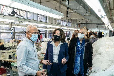 LG Kathy Hochul visits Four Seasons Fashion as part of women-owned nonprofit Garment District for Gowns on 39th street of Manhattan. LG was touring Four Season Fashion company owned by Tony Singh (L) and joined by Manhattan borough President Gail Brewer (R). Nonprofit organization helped already to manufacture more than 300,000 PPE and sent them to New York State hospitals.