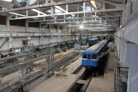 Stock-billede af A metro carriage that has 500,000km mileage goes through regular maintenance in the metro train repair shop in Dnipro, central Ukraine.