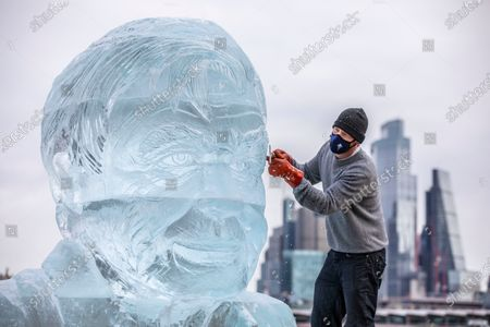 Nick Smith sculptor at Hamilton Ice Sculptors makes last touches to a giant ice sculpture of Sir David Attenborough that will stand on the Southbank in the centre of London to demonstrate the Arctic ice melt caused by one UK person EVERY FORTNIGHT.