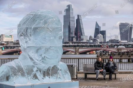 Stock Image of A giant ice sculpture of Sir David Attenborough that will stand on the Southbank in the centre of London to demonstrate the Arctic ice melt caused by one UK person EVERY FORTNIGHT.