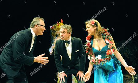 Stock Image of 'The Little Hut'  - Aiden Gillett (Philip), Tom Turner (The Stranger), Robert Portal (Henry) and Janie Dee (Susan)
