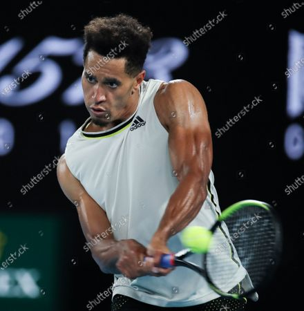 Michael Mmoh hits a return during men's singles 2nd round match between Rafael Nadal of Spain and Michael Mmoh of the United States at the Australian Open 2021 tennis tournament in Melbourne Park, Melbourne, Australia on Feb. 11, 2021.