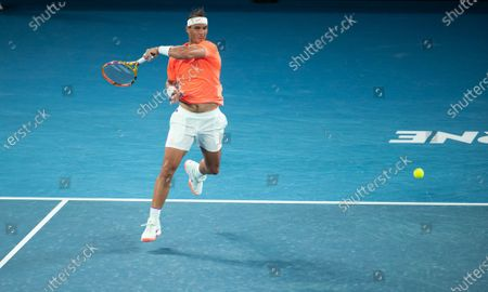 Rafael Nadal hits a return during men's singles 2nd round match between Rafael Nadal of Spain and Michael Mmoh of the United States at the Australian Open 2021 tennis tournament in Melbourne Park, Melbourne, Australia on Feb. 11, 2021.