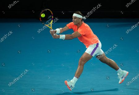 Stock Image of Rafael Nadal hits a return during men's singles 2nd round match between Rafael Nadal of Spain and Michael Mmoh of the United States at the Australian Open 2021 tennis tournament in Melbourne Park, Melbourne, Australia on Feb. 11, 2021.