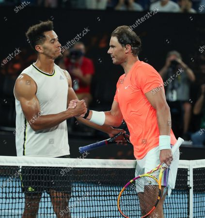 Rafael Nadal (R) reacts with Michael Mmoh after men's singles 2nd round match between Rafael Nadal of Spain and Michael Mmoh of the United States at the Australian Open 2021 tennis tournament in Melbourne Park, Melbourne, Australia on Feb. 11, 2021.