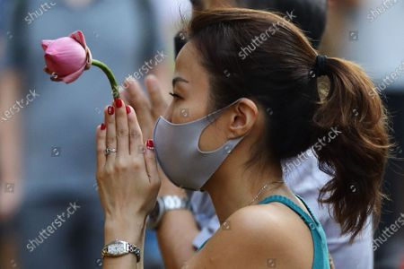 A devotee wearing protective mask offers prayers to seek blessings from the Goddess of Mercy at the Kwan Im Thong Hood Cho temple as Singapore prepares to usher in the Lunar New Year amid the COVID-19 pandemic. The government has introduced a capped of 8 unique visitors per household per day and a maximum visit of 2 households daily to minimise the spread of the COVID-19 pandemic. On February 12, people around the world will welcome the Year of the Ox, one of the most anticipated holidays on the Chinese calendar.