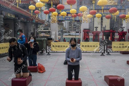 People are seen drawing a fortune stick inside Wong Tai Sin Temple. The Lunar New Year will mark the year of the Ox in the Chinese Zodiac Calendar.