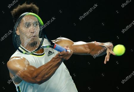 United States' Michael Mmoh makes a forehand return to Spain's Rafael Nadal during his second round match at the Australian Open tennis championship in Melbourne, Australia
