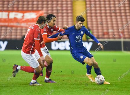 Christian Pulisic of Chelsea takes on Callum Brittain and Toby Sibbick of Barnsley