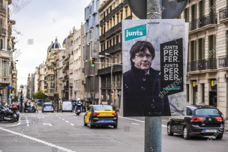 Election posters of former president Carles Puigdemont are seen displayed throughout the city. The electoral campaign for the elections to the government of Catalonia of the 14F reaches its last days with a rather scarce presence of electoral posters in the public space.