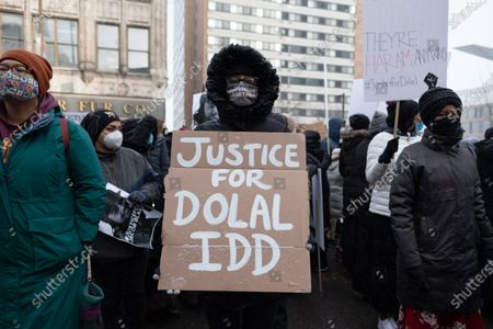 A protester holds a sign calling for justice for Dolal Idd, who was shot and killed by Minneapolis Police during a sting operation in December 2020, on January 9, 2021 in Minneapolis, United States. Hundreds of Black Lives Matter protesters and families members of Dolal Idd gathered in downtown Minneapolis, MN to protest the police killing of Dolal Idd during a sting operation. Protesters also spoke out against the decision by the Kenosha County district attorney not to charge Rusten Sheskey, the officer who shot Jacob Blake seven times in the back.