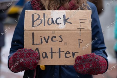 A protester holds a sign in support of Black lives, on January 9, 2021 in Minneapolis, United States. Hundreds of Black Lives Matter protesters and families members of Dolal Idd gathered in downtown Minneapolis, MN to protest the police killing of Dolal Idd during a sting operation. Protesters also spoke out against the decision by the Kenosha County district attorney not to charge Rusten Sheskey, the officer who shot Jacob Blake seven times in the back.