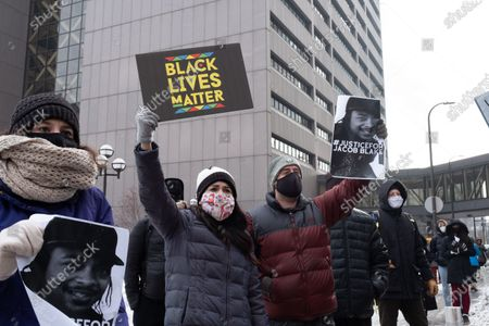 Protesters gather in downtown Minneapolis to protest the decision not to charge Kenosha police officer Rusten Sheskey, on January 9, 2021 in Minneapolis, United States. Hundreds of Black Lives Matter protesters and families members of Dolal Idd gathered in downtown Minneapolis, MN to protest the police killing of Dolal Idd during a sting operation. Protesters also spoke out against the decision by the Kenosha County district attorney not to charge Rusten Sheskey, the officer who shot Jacob Blake seven times in the back.