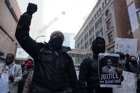 Protesters march through downtown Minneapolis to demand that the officers who shot and killed Dolal Idd be held accountable, on January 9, 2021 in Minneapolis, United States. Hundreds of Black Lives Matter protesters and families members of Dolal Idd gathered in downtown Minneapolis, MN to protest the police killing of Dolal Idd during a sting operation. Protesters also spoke out against the decision by the Kenosha County district attorney not to charge Rusten Sheskey, the officer who shot Jacob Blake seven times in the back.
