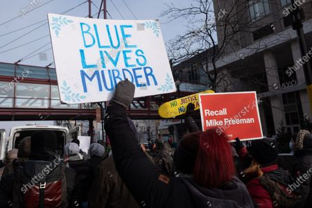 Protesters condemn law enforcement during a march for Dolal Idd in downtown Minneapolis, on January 9, 2021 in Minneapolis, United States. Hundreds of Black Lives Matter protesters and families members of Dolal Idd gathered in downtown Minneapolis, MN to protest the police killing of Dolal Idd during a sting operation. Protesters also spoke out against the decision by the Kenosha County district attorney not to charge Rusten Sheskey, the officer who shot Jacob Blake seven times in the back.
