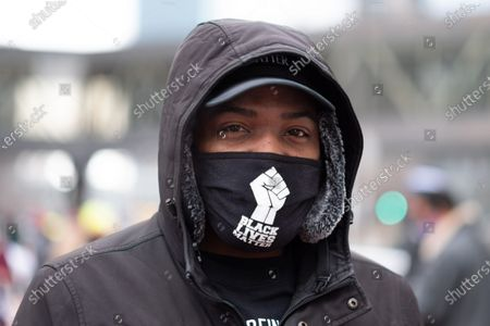 A protester attends a rally condemning police violence in downtown Minneapolis, MN, on January 9, 2021 in Minneapolis, United States. Hundreds of Black Lives Matter protesters and families members of Dolal Idd gathered in downtown Minneapolis, MN to protest the police killing of Dolal Idd during a sting operation. Protesters also spoke out against the decision by the Kenosha County district attorney not to charge Rusten Sheskey, the officer who shot Jacob Blake seven times in the back.