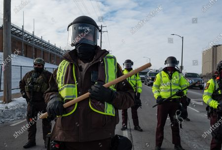 State Patrol officers stand in front of a freeway exit in St. Paul to block marchers on Martin Luther King Jr. Day. January 18, 2021.