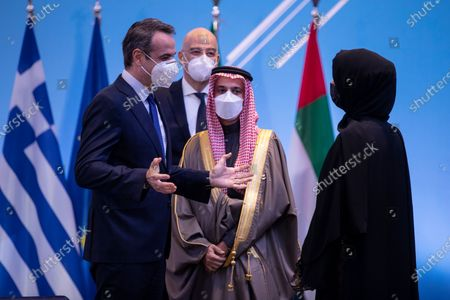 Greek Prime Minister Kyriakos Mitsotakis (L) speaks with Reem Ebrahim Al-Hashimi (R), Emirati Minister of State for International Cooperation and Saudi Foreign Minister Prince Faisal bin Farhan Al-Saud (2-R) during the 'Philia Forum' held in Athens, Greece, 11 February 2021. The Foreign Affairs Ministers of four Mediterranean Arab and Gulf states and two European countries will participate in the first 'Philia Forum' (Friendship Forum), to be held in Athens. Under the title 'Building Friendship, Peace and Prosperity from the Mediterranean to the Gulf', the foreign ministers of Greece and Cyprus, Bahrain, Egypt, Saudi Arabia and the United Arab Emirates will discuss strengthening collaborations against regional security challenges and will also talk about the coronavirus pandemic. France, Iraq and Jordan have also been invited to participate, the Greek ministry said in a statement.