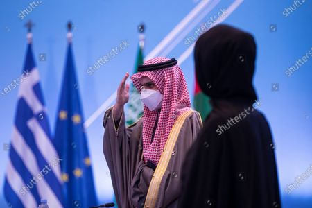 Stock Photo of Reem Ebrahim Al-Hashimi (R), Emirati Minister of State for International Cooperation and Saudi Foreign Minister Prince Faisal bin Farhan Al-Saud (L) participate in the  'Philia Forum' held in Athens, Greece, 11 February 2021. The Foreign Affairs Ministers of four Mediterranean Arab and Gulf states and two European countries will participate in the first 'Philia Forum' (Friendship Forum), to be held in Athens. Under the title 'Building Friendship, Peace and Prosperity from the Mediterranean to the Gulf', the foreign ministers of Greece and Cyprus, Bahrain, Egypt, Saudi Arabia and the United Arab Emirates will discuss strengthening collaborations against regional security challenges and will also talk about the coronavirus pandemic. France, Iraq and Jordan have also been invited to participate, the Greek ministry said in a statement.