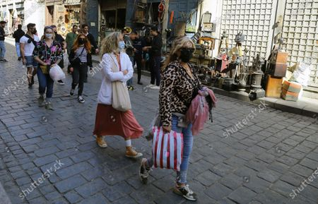 Stock Picture of Tourists walk at the historical street of Elmoez Lideen Ella in Old Cairo, Egypt, 11 February 2021. Egypt marks the 10th anniversary of the resignation of former president Hosni Mubarak on 11 February 2021.