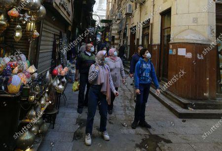 Stock Image of People walk in Khan al-Khalili bazaar in old Cairo, Egypt, 11 February 2021. Egypt marks the 10th anniversary of the resignation of former president Hosni Mubarak on 11 February 2021.