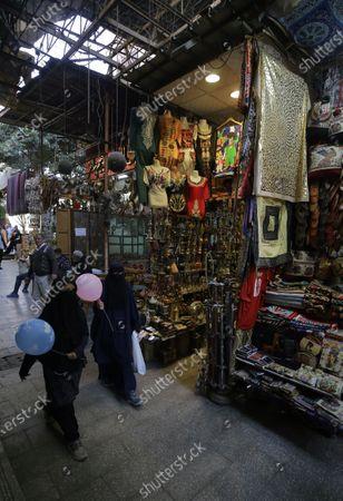 Egyptian women walk in Khan al-Khalili bazaar in old Cairo, Egypt, 11 February 2021. Egypt marks the 10th anniversary of the resignation of former president Hosni Mubarak on 11 February 2021.