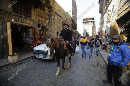 Stock Photo of An Egyptian soldier on horseback patrols the historical street of Elmoez Lideen Ella in Old Cairo, Egypt, 11 February 2021. Egypt marks the 10th anniversary of the resignation of former president Hosni Mubarak on 11 February 2021.