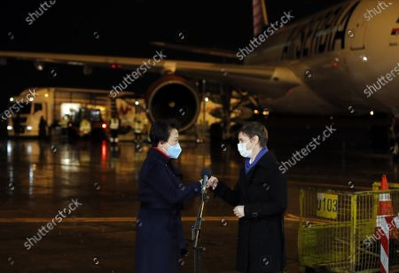 Serbian Prime Minister Ana Brnabic (R) and Chinese Ambassador to Serbia Chen Bo attend a welcoming event of China's Sinopharm vaccine at the Belgrade Airport, Serbia, Feb. 10, 2021. A second shipment of Sinopharm's COVID vaccine arrived from China at the Belgrade Airport on Wednesday night.