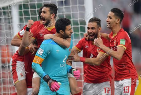 Al Ahly goalkeeper Mohamed El-Shenawy (C) and teammates celebrate after winning the penalty shoot-out of the 3rd place match between Al Ahly SC and SE Palmeiras at the FIFA Club World Cup in Al Rayyan, Qatar, 11 February 2021.