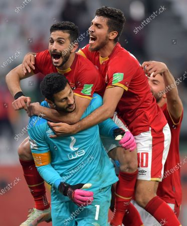 Al Ahly goalkeeper Mohamed El-Shenawy (bottom) and teammates celebrate after winning the penalty shoot-out of the 3rd place match between Al Ahly SC and SE Palmeiras at the FIFA Club World Cup in Al Rayyan, Qatar, 11 February 2021.