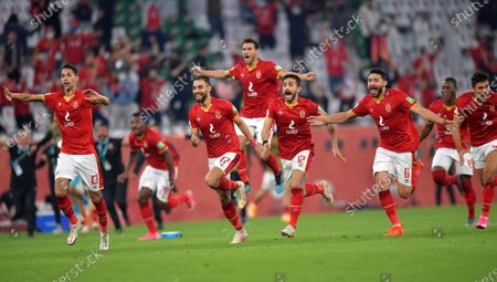 Al Ahly players celebrate after winning the penalty shoot-out of the 3rd place match between Al Ahly SC and SE Palmeiras at the FIFA Club World Cup in Al Rayyan, Qatar, 11 February 2021.