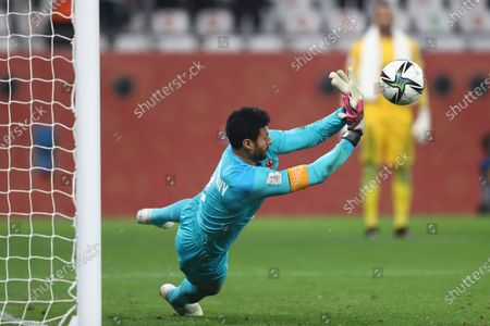 Ahly's Mohamed El Shenawy saves a penalty shot during the Club World Cup third place soccer match between Palmeiras and Al Ahly at the Education City stadium in Al Rayyan, Qatar