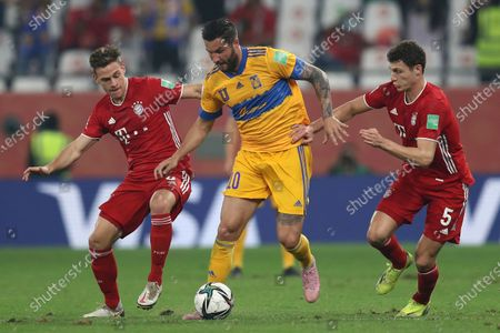 Tigres' Andre Gignac, center, fights for the ball with Bayern's Joshua Kimmich, left, and Bayern's Benjamin Pavard during the Club World Cup final soccer match between FC Bayern Munich and Tigres at the Education City stadium in Al Rayyan, Qatar