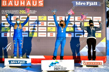Stock Image of Charlotte Bankes (C) of Britain celebrates on the podium after winning the women's big final at the FIS Snowboard Cross World Championships in Idre Fjall, Sweden, 11 February 2021. Bankes won ahead of second placed Michela Moioli (L) of Italy and third placed Eva Samkova (R) of the Czech Republic.