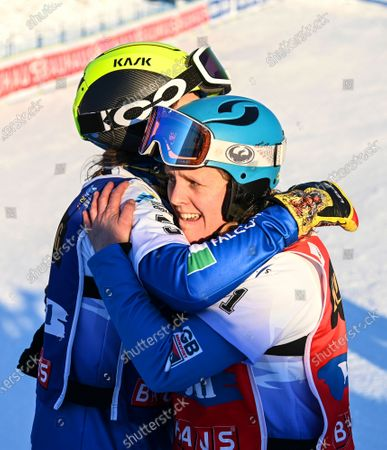 Charlotte Bankes (R) of Britain celebrates after winning the women's big final at the FIS Snowboard Cross World Championships in Idre Fjall, Sweden, 11 February 2021. Bankes won ahead of second placed Michela Moioli (L) of Italy.