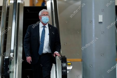 Sen. Roger Wicker, R-Miss., gets off an escalator on Capitol Hill in Washington, before the start of the third day of the second impeachment trial of former President Donald Trump