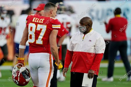 Stock Photo of Kansas City Chiefs offensive coordinator Eric Bieniemy speaks with Kansas City Chiefs tight end Travis Kelce (87) before before the NFL Super Bowl 55 football game between the Tampa Bay Buccaneers and the Kansas City Chiefs, in Tampa, Fla. The Tampa Bay Buccaneers defeated the Kansas City Chiefs 31-9