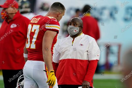 Kansas City Chiefs offensive coordinator Eric Bieniemy speaks with Kansas City Chiefs tight end Travis Kelce (87) before before the NFL Super Bowl 55 football game between the Tampa Bay Buccaneers and the Kansas City Chiefs, in Tampa, Fla. The Tampa Bay Buccaneers defeated the Kansas City Chiefs 31-9