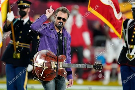 Eric Church performs the national anthem with Jazmine Sullivan before the NFL Super Bowl 55 football game between the Kansas City Chiefs and Tampa Bay Buccaneers, in Tampa, Fla. The Tampa Bay Buccaneers defeated the Kansas City Chiefs 31-9