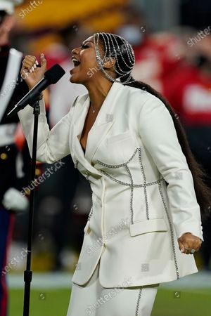 Jazmine Sullivan performs the national anthem with Eric Church before the NFL Super Bowl 55 football game between the Kansas City Chiefs and Tampa Bay Buccaneers, in Tampa, Fla. The Tampa Bay Buccaneers defeated the Kansas City Chiefs 31-9
