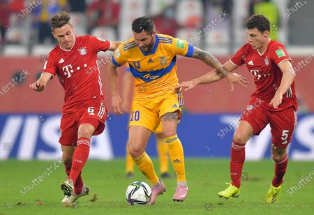 Andre-Pierre Gignac (C) of Tigres in action against Joshua Kimmich (L) and Benjamin Pavard (R) of Bayern Munich during the final soccer match between Bayern Munich and Tigres UANL at the FIFA Club World Cup in Al Rayyan, Qatar, 11 February 2021.