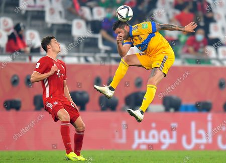 Andre-Pierre Gignac (R) of Tigres in action against Benjamin Pavard (L) of Bayern Munich during the final soccer match between Bayern Munich and Tigres UANL at the FIFA Club World Cup in Al Rayyan, Qatar, 11 February 2021.