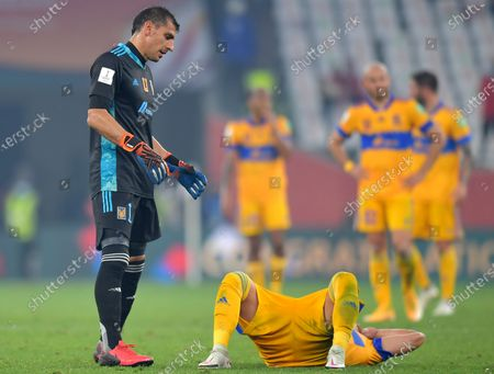 Stock Photo of Goalkepeer Nahuel Guzman (L) of Tigres and his teammates react after losing the final soccer match between Bayern Munich and Tigres UANL at the FIFA Club World Cup in Al Rayyan, Qatar, 11 February 2021.