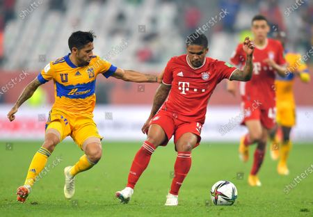 Douglas Costa (R) of Bayern Munich in action against Miguel Ortega (L) of Tigres during the final soccer match between Bayern Munich and Tigres UANL at the FIFA Club World Cup in Al Rayyan, Qatar, 11 February 2021.