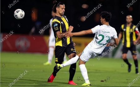 Al-Ahli's player Abdullah Hassoun (R) in action against Al-Ittihad's Aleksandar Prijovic (L) during the Saudi Professional League soccer match between Al-Ahli and Al-Ittihad at King Abdullah Sport City Stadium, 30 kilometers north of Jeddah, Saudi Arabia, 11 February 2021.