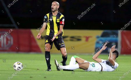 Al-Ahli's player Ali Al-Asmari (R) in action against Al-Ittihad's Karim El Ahmadi (L) during the Saudi Professional League soccer match between Al-Ahli and Al-Ittihad at King Abdullah Sport City Stadium, 30 kilometers north of Jeddah, Saudi Arabia, 11 February 2021.