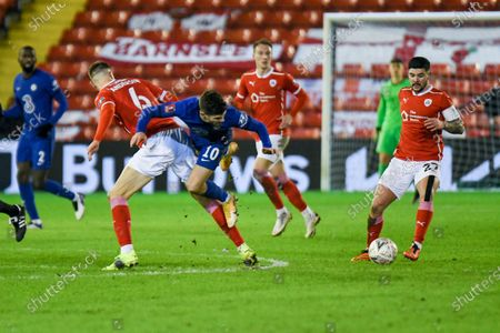 Barnsley defender Mads Juel Andersen (6) tackles Chelsea forward Christian Pulisic (10) during the FA Cup 5th round match between Barnsley and Chelsea at Oakwell, Barnsley