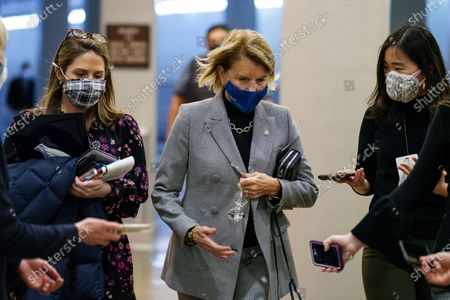 Senator Shelley Moore Capito, a Republican from West Virginia, wears a protective mask talking with members of the press in the Senate Subway at the U.S. Capitol in Washington, D.C., U.S.,. House prosecutors used the second day of Donald Trump's impeachment trial to detail a months-long campaign by the former president to stoke hatred and encourage violence over the election results that they said culminated in the mob attack on the U.S. Capitol that he then did little to stop.