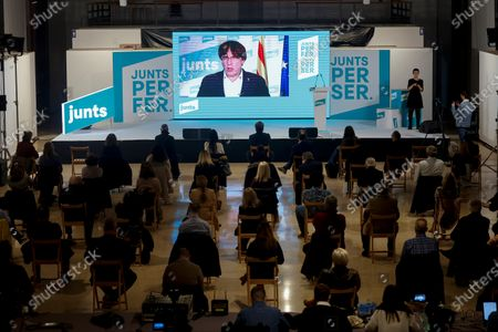Former Catalan President Carles Puigdemont (C) attends via video conference a campaign rally of pro-independence party Junts per Catalunya (JxCat) held in Tarragona, Spain, 11 February 2021. Spanish state of Catalonia will hold regional elections on the upcoming 14 February.